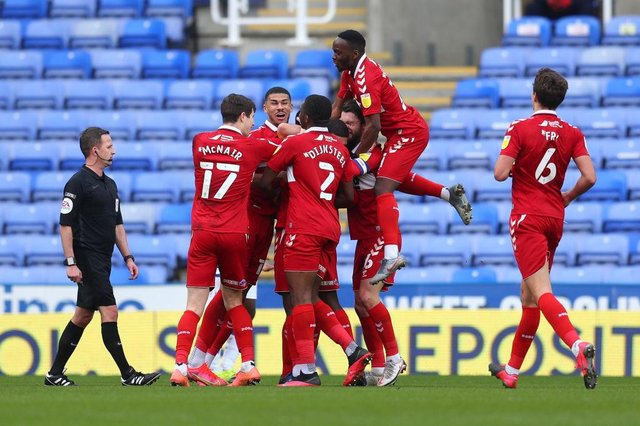 Marc Bola of Middlesbrough celebrates with team-mates after scoring against Reading.