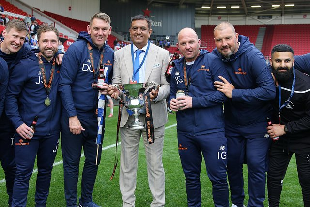 Hartlepool United chairman Raj Singh with the club's coaching staff, Ross Turnbull second from right.