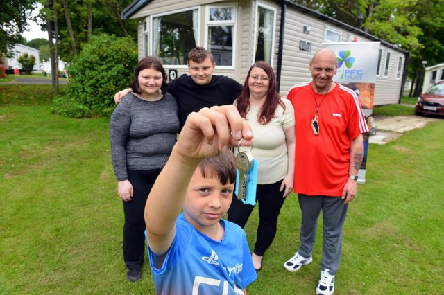 Hartlepool family Darren and Janet Cooper with children Abbey, 16, Freddie, 13 and, front, Alex , nine, with the keys for one of the Hartlepool-based PFC Trust's respite caravans at Cresswell Towers, in Northumberland.