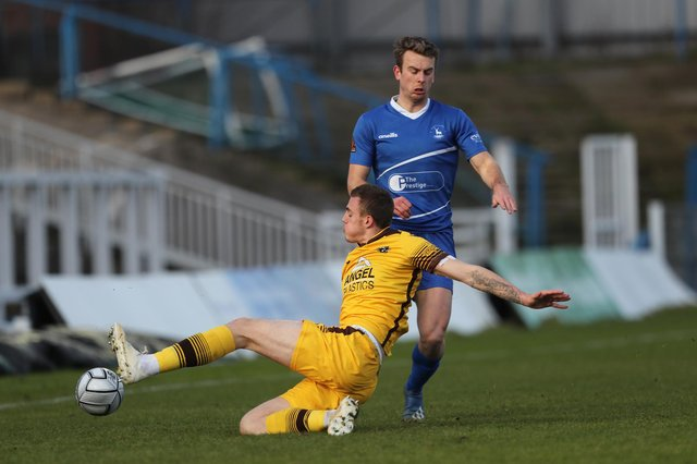 Sutton United's Ben Goodliffe clears from Rhys Oates of Hartlepool United during the Vanarama National League match between Hartlepool United and Sutton United at Victoria Park, Hartlepool on Saturday 30th January 2021. (Credit: Mark Fletcher | MI News)