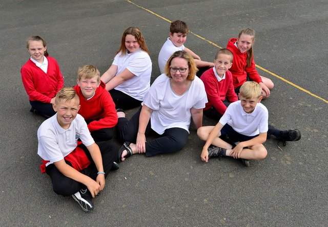 Headteacher Caroline Reed with pupils from Rossmere Primary School.