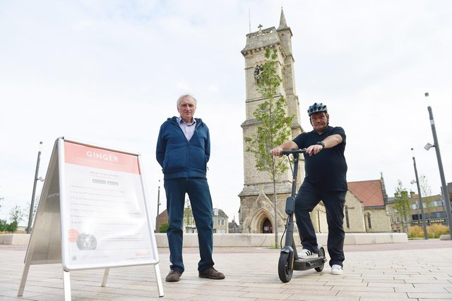Peter Gowland (left) and Marty Fishwick with some of the Ginger electric scooters in Church Square, Hartlepool. Picture by FRANK REID