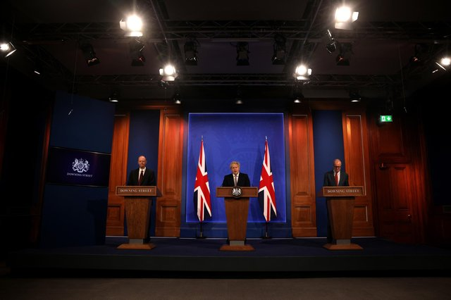 Chief Medical Officer Professor Chris Witty, Prime Minister Boris Johnson and Chief Scientific Adviser Sir Patrick Vallance attend a virtual press conference to announce changes to lockdown rules. Picture: Dan Kitwood-WPA Pool/Getty Images.