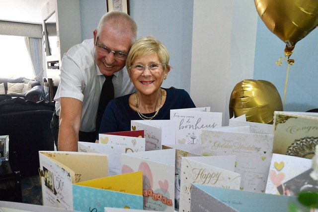 Brenda and Den Loynes with some of the many cards they received for their Golden Wedding anniversary.  Picture by FRANK REID