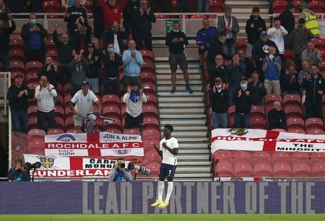 Bukayo Saka celebrates scoring for England against Austria.