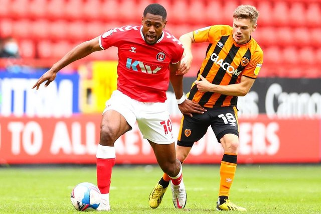 Chuks Aneke of Charlton Athletic battles for possession.