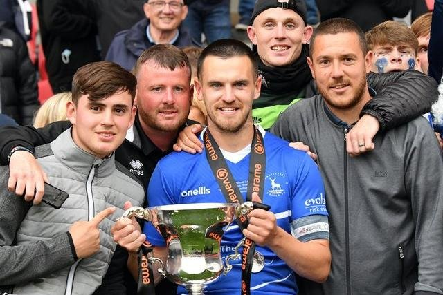 Ryan Donaldson with the promotion final trophy.