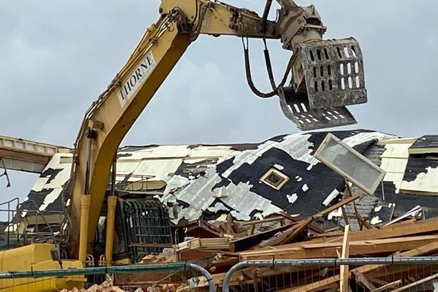 A digger makes short work of buildings that were no longer fit for purpose.