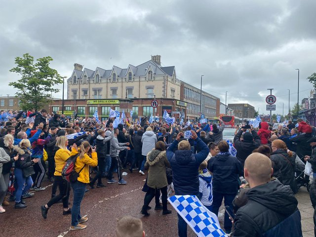 Crowds wait for the bus in Victoria Road.