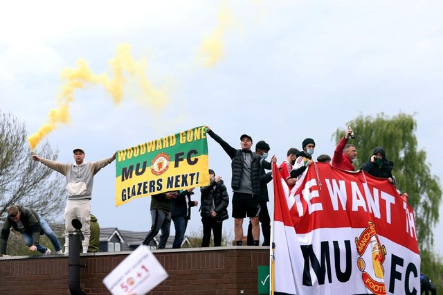 Fans holding up banners as they protest against the Glazer family, owners of Manchester United. Issue date: Monday May 3, 2021.