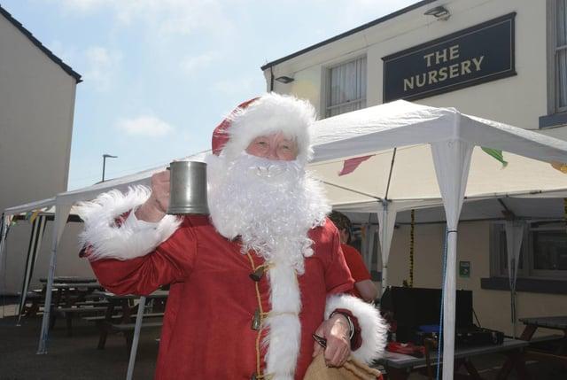 Santa raises a glass at the Nursery Inn. Picture: North News.