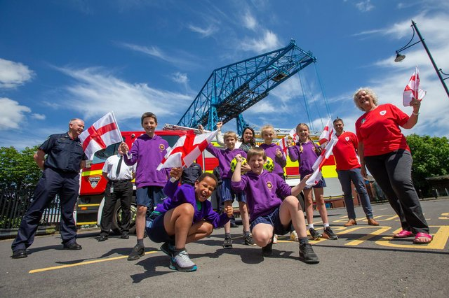 Cleveland Fire Brigade's Andrew Bright, teaching assistant Christine Walpole, Head of Commercial at Middlesbrough FC Lee Fryett, Middlesbrough Council's road safety officer Lynn Hepworth, and pupils from St Bernadette's Primary School in Middlesbrough.