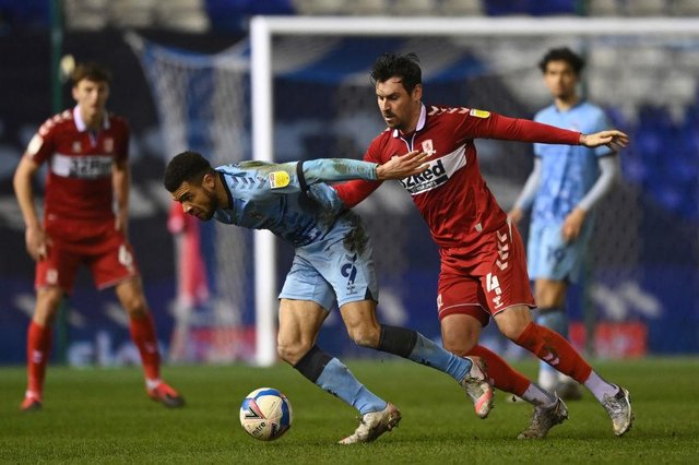 Maxime Biamou of Coventry City is challenged by Grant Hall of Middlesborough.