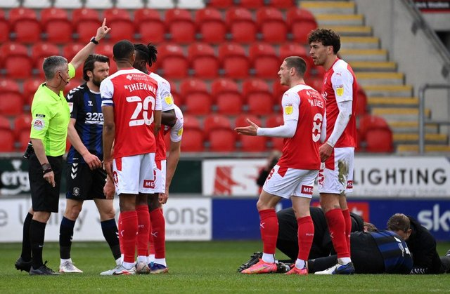 Match Referee Darren Bond instructs Matt Crooks of Rotherham United to leave the field after being sent off.