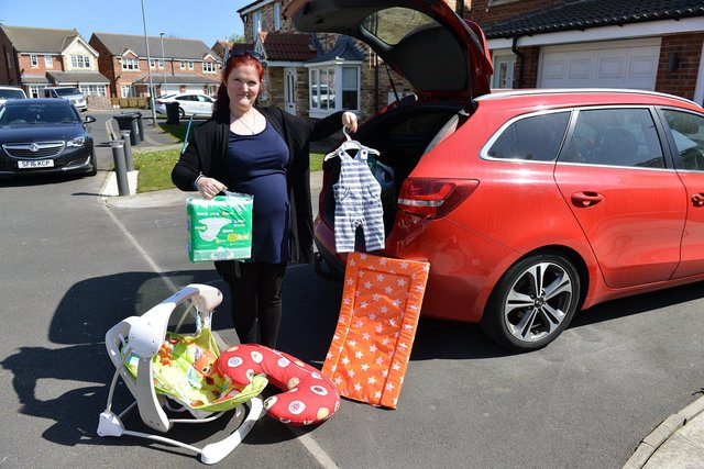 Emilie De Bruijn from Hartlepool Baby Bank loading items into her car ready for delivery. Picture by FRANK REID