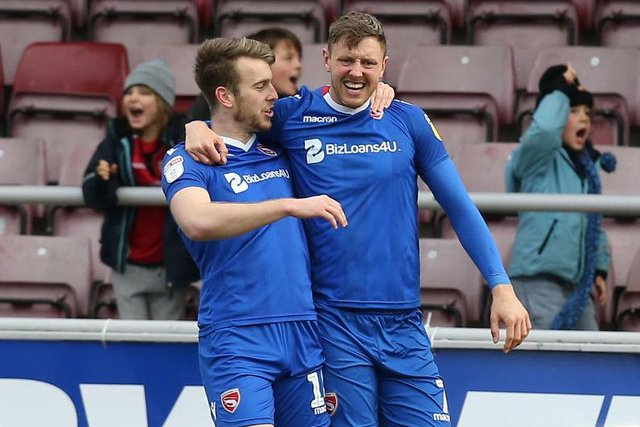 Richie Bennett of Morcambe celebrates with team mate Rhys Oates after scoring his sides goal during the Sky Bet League Two match between Northampton Town and Morecambe at PTS Academy Stadium on January 26, 2019 (Photo by Pete Norton/Getty Images)