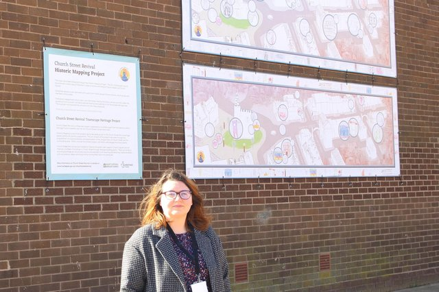 Emma Ackroyd, the council's townscape and heritage project officer, by the new banners in Church Street.