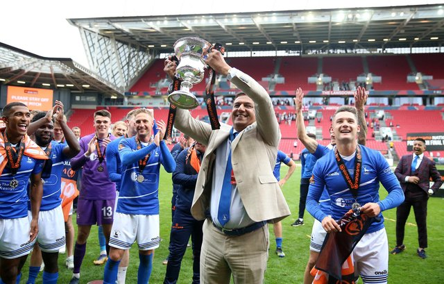Hartlepool United owner Raj Singh celebrates with the trophy after winning the shoot-out and promotion after the Vanarama National League play-off final at Ashton Gate, Bristol (photo: Nigel French)