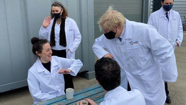 Boris Johnson greets Hart Biologicals worker Kensey Robinson by touching elbows during his visit to the Hartlepool business on Thursday.