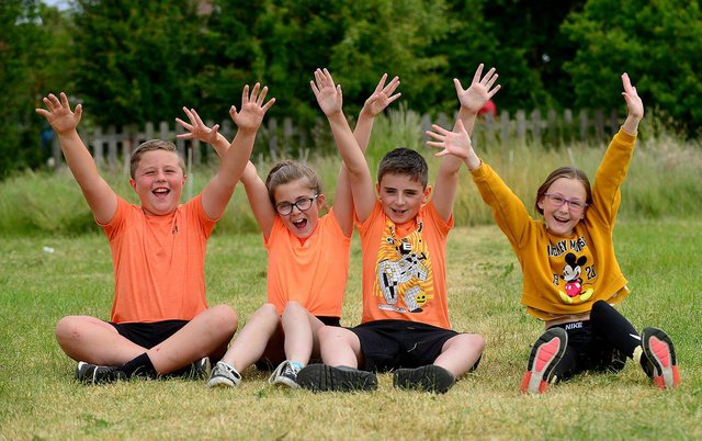 St Aidan's Primary school pupils (left to right) Logan Marshall, Poppy McDonald, Frankie Sheehan and Millei Sowerby cheer on their fellow pupils who are taking part in a charity run in memory of Keisha Watson.