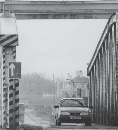A car crosses the Middleton Bridge in the weeks shortly before its demolition.