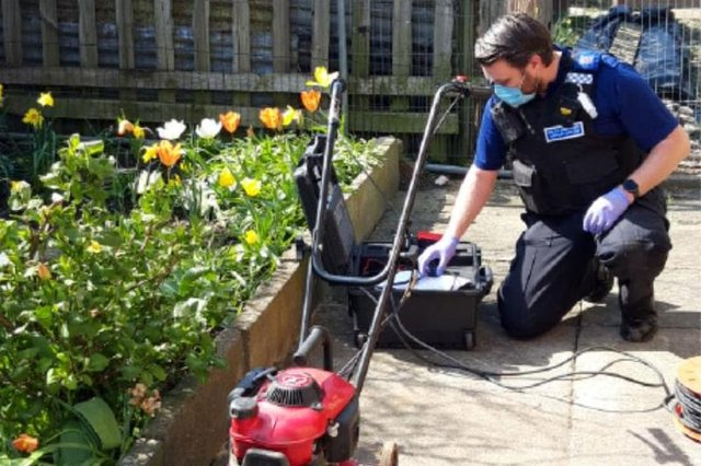 An officer property marks a lawnmower at Burn Valley allotments during the day of action.