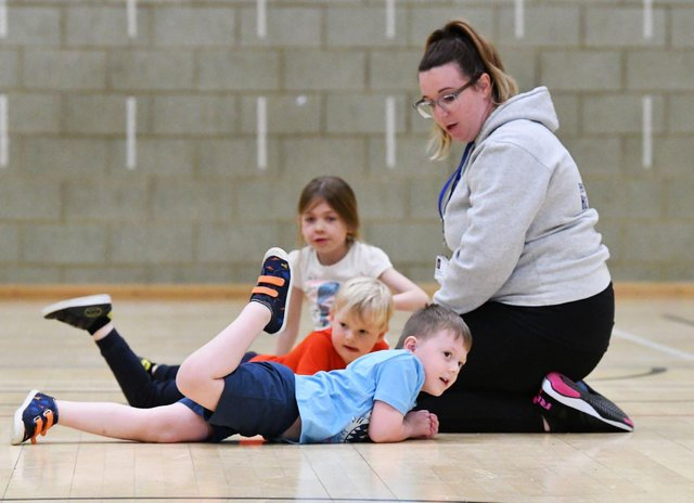 Vic Weighill enjoying a rough and tumble with Oliver Coraigan, Isaac Harland and Izabelle Berry during the Funability session held at Brierton Community Sports Centre.