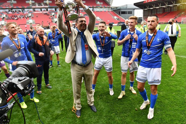 Hartlepool United chairman Raj Singh celebrates promotion with the players following their penalty shoot-out victory over Torquay United on Sunday.