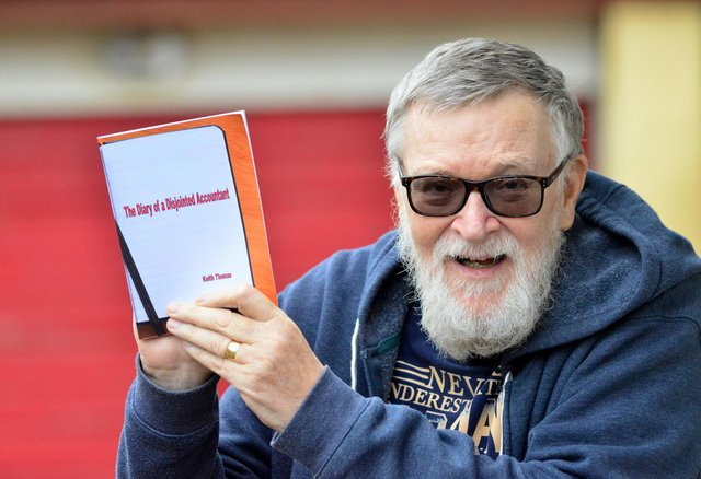Keith Thomas with a copy of his book The Diary of a Disjointed Accountant. Picture by FRANK REID