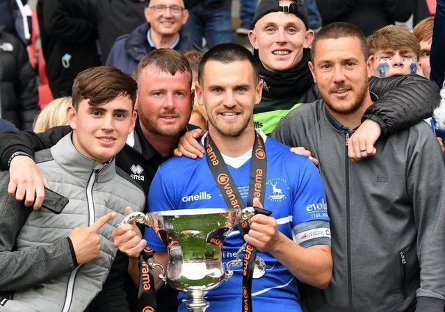 Hartlepool United captain Ryan Donaldson with the National League promotion final trophy. Former teammate and Morpeth Town midfielder Liam Noble (right)