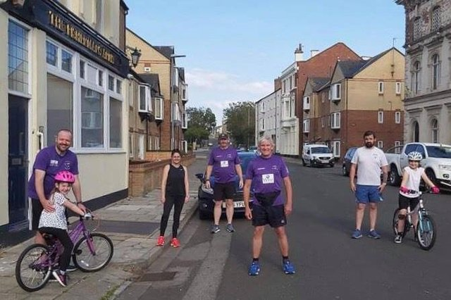 Phil Holbrook (centre) and a socially distanced group doing the summer run last year from the Fisherman's Arms on the Headland.