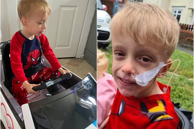 Noah Griffiths who was overjoyed to receive a special present of an electric toy car.