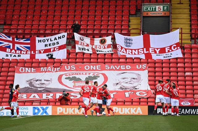 Daryl Dike of Barnsley FC  celebrates with teammates after scoring against Middlesbrough.