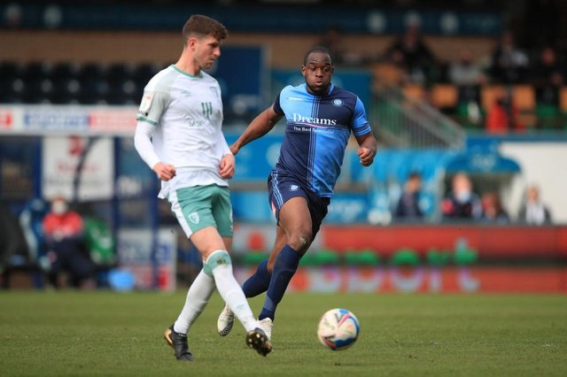 Chris Mepham of AFC Bournemouth in action with Uche Ikpeazu of Wycombe Wanderers.