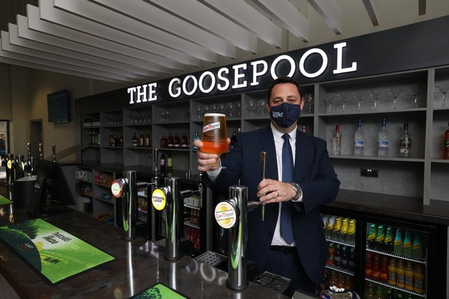 Mayor Ben Houchen pouring a pint in the new The Goosepool Bar