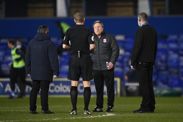 Neil Warnock, manager of Middlesborough, interacts with Match Referee Graham Scott at the half time interval during the Sky Bet Championship match between Coventry City and Middlesbrough at St Andrew's Trillion Trophy Stadium on March 2, 2021.