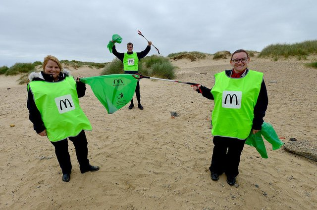 (Left to right) Vicky Vale, Ted Brown and Denise Hopkins-Noble of Burn Road, Town Center and Marina McDonalds at the start of their litter picks.  Photo by FRANK REID