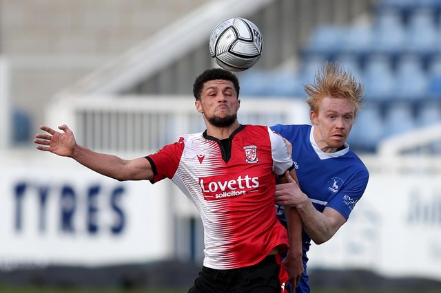 Luke Williams of Hartlepool United and Kane Ferdinand of Woking during the Vanarama National League match between Hartlepool United and Woking at Victoria Park, Hartlepool on Saturday 20th March 2021. (Credit: Chris Booth | MI News)