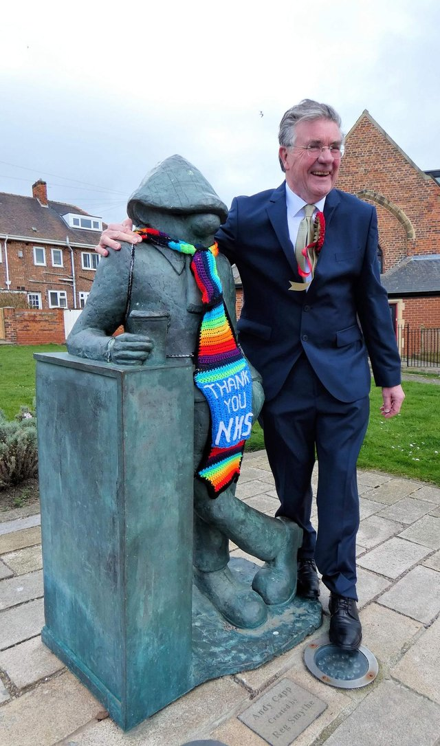 North East Party candidate Hilton Dawson next to Hartlepool's Andy Capp statue.