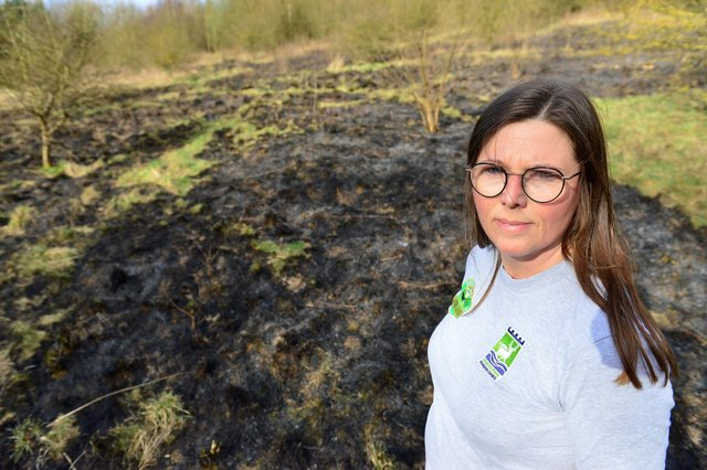 Claire McDonald, senior outreach officer at Summerhill Country Park, next to the area of land that was set on fire.