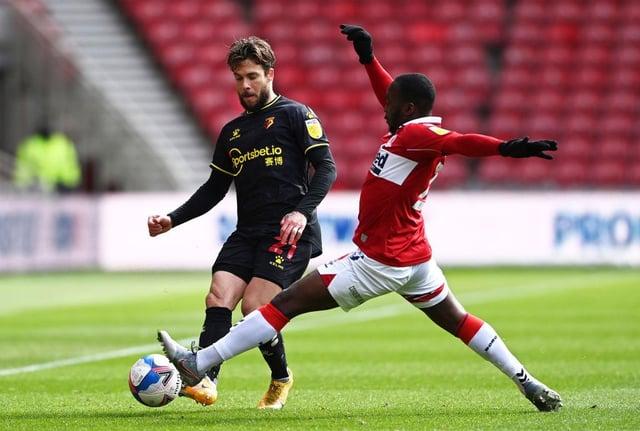 Kiko Femenia of Watford passes past Neeskens Kebano of Middlesbrough.