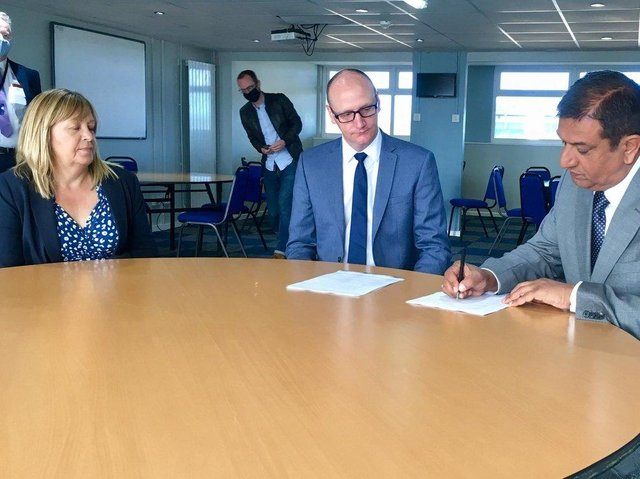 Hartlepool United chairman Raj Singh (right) signs the Memorandum of Understanding at Victoria Park with Cllr Shane Moore and Hartlepool Borough Council managing director Denise McGuckin.
