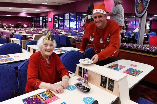 Manager Neil Lamb with customer Rose Samuels celebrating Christmas at Mecca Hartlepool.