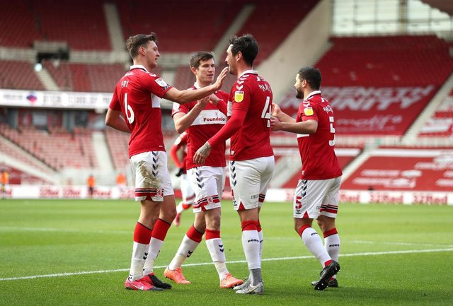 Grant Hall of Middlesbrough celebrates with teammates after scoring against Stoke.