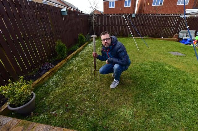 Glen Hughes in his boggy garden.