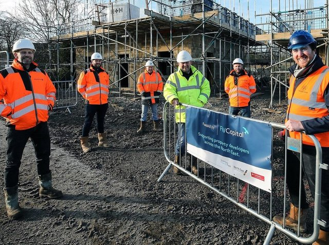 Acland Homes'Stephen Litherland, far right, with construction partners.