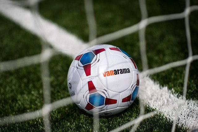 The match ball on a plastic 3G pitch at Sutton United (Photo by Justin Setterfield/Getty Images)