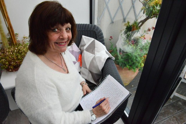 Author Breffni Martin writing her latest book.