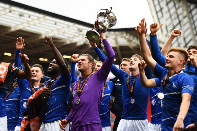 Players of Hartlepool United celebrate with the Vanaram National League Trophy during the Vanarama National League Play-Off Final match between Hartlepool United and Torquay United at Ashton Gate on June 20, 2021 in Bristol, England. (Photo by Harry Trump/Getty Images)