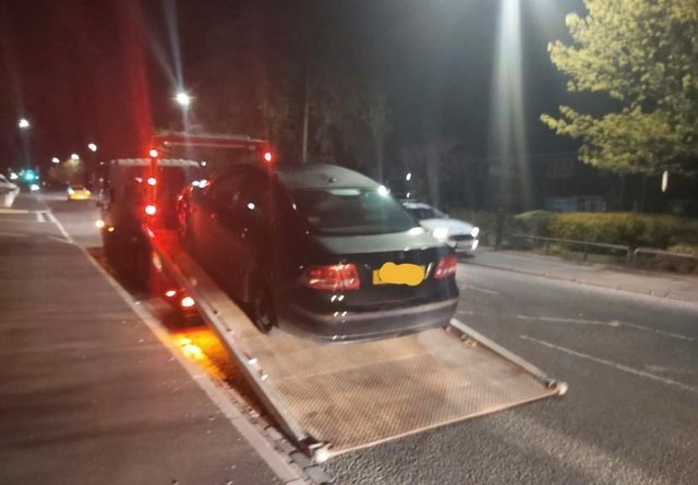 The Saab is towed away after the stop and search in Raby Road, Hartlepool.